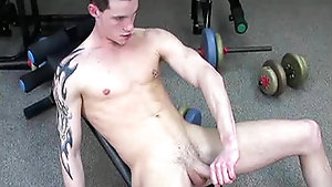 Pierced nipple twink wanks his cock after a hard workout
