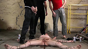 Slender young pale twink gets tied down on the floor